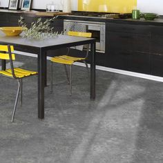 An intricate design is featured on a modern color palette that is sure to add a contemporary feel and a charismatic visual appeal to your home. It has a wear layer of 0.25mm making it highly durable and hard-wearing. The 3.0mm thickness of the vinyl makes it suitable for both domestic and commercial applications. Offers a warranty of 10 years. Vinyl Flooring Uk, Stone Flooring, Flooring Ideas, Kitchen Flooring, Modern Color Palette, 2020 Design, 10 Years, Kitchens, Commercial