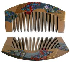 Artistically hand-painted, gilded and engraved Japanese hair comb with folding Japanese fans motif adorned with mother-of-pearl inlay in shape of flowers. Signed by artist 'Nami-e'. An exquisite addition to any collection.   About 1900's., Meiji period