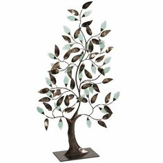 """Metal & Glass Tree of Life, 23"""" wide x 7.75"""" deep x 35.5"""" high, reg 99.95 clearance $49.98 -- """"A universal symbol in many cultures, a tree of life represents strength, beauty and the human need to plant roots and branch out. Ours is crafted of glass and iron and hand-painted for a one-of-a-kind look.""""  Antiqued gold/turquoise."""