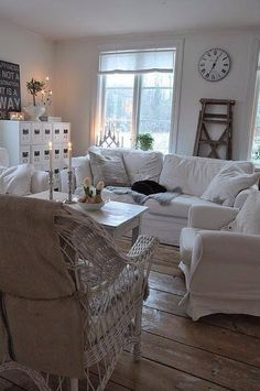 Love the neutral whites, rustic flooring, and wicker chair.