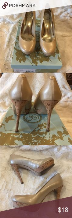 Round toe pearlized cream pump! Dark cream pearlized pump. 4 inch heel. Some wear on heel shown in pictures. Jessica Simpson Shoes Heels