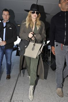 Khloe Kardashian wears olive green again as she leave Sydney #dailymail