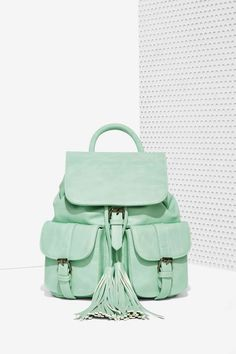 Nasty Gal x Nila Anthony Azalea Cargo Backpack can fit all your summer gear and adds a fresh pop of mint to any look.