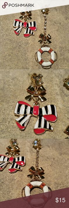 "Betsey Johnson Life Ring & Bow Asymmetric Earrings New, never worn, no tag, Betsey Johnson mismatched asymmetrical boat or lifeguard life ring & red white & blue striped bow long dangle earrings with goldenbows in multiple shades of enamel over shiny gold tone metal. Aurora borealis (iridescent rainbow sheen ) crystal stones at the stud posts, the ring has a rhinestone chain. Life saver hangs 2.75"" long from post, bow a little over 2.25"".  Thank you for visiting my closet, and happy…"