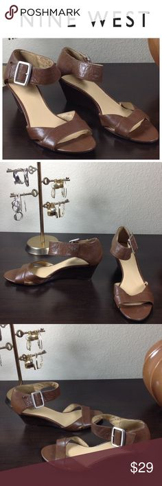 Nine West Brown Leather Low Wedge Sandals Brown leather low wedge sandals with large silver buckle. Exterior is in great condition with no visible scratches or marks. Lots of peeling on the interior (see pics). Thanks for your interest! Please checkout the rest of my closet. Nine West Shoes Sandals