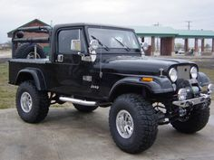 jeep scrambler - Bing Images OK - this one isn't actually mine, but it looks pretty close. Just add a few stickers and some bondo - and oh yeah, my tire carrier is on the roll bar.