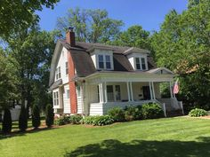 The double windows on the second floor and the front porch help transform this well-maintained Dutch colonial home in Kirkwood.