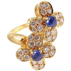 VAN CLEEF & ARPELS Diamond Cabochon Sapphire Flower Yellow Gold Ring. 18k Yellow Gold Diamond & Cabochon Sapphire Flower Ring by Van Cleef & Arpels.  With 32 brilliant round cut diamonds VVS clarity, F color Total weight .63ct 2 cabochon sapphire .64ct. France, c 1990