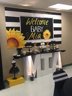 Sunflower themed baby shower display and backdrop
