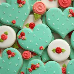 Mint green heart cookies with pink and red roses.