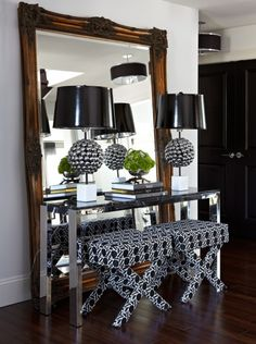great use of a mirror,..... and console,.... and stools