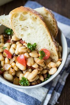 Sometimes, all you want for dinner is bread, butter, and wine. Class that up a bit with this Tuscan White Bean Salad! Eat on top of buttered crusty bread and serve with a glass of red wine - dinner i(Butter Beans Red Wines) Orzo, Bean Salad Recipes, Bean Salads, Veggie Recipes, Vegetarian Recipes, Warm Salad, Wine Dinner, Butter Recipe, Recipe 21