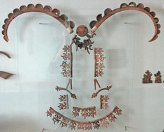 Mountain goat horns decoration with harness and bridle hardware. / Pazirik-Altai area in BC Kurgan 1 Tuek. 430-420BC