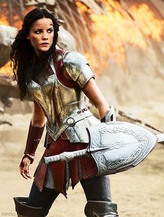 Lady Sif (Jaimie Alexander) I can't get enough of her outfit. <--- it's so refreshing to see super heroines like this, clothed and armoured! And she's still sexy!