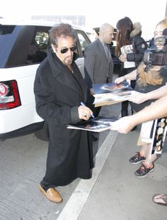 Al Pacino leaves LAX, but not before signing a few autographs