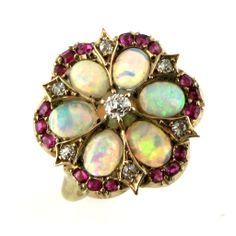 An Edwardian Opal, Ruby & Diamond Cluster Ring