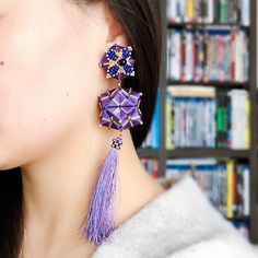 "English:These ""Ruyi"" Clip earrings are made of ""Caizongs"", traditional Chinese ornaments composed of folded paper and sewing threads that are reinterpreted in a contemporary..."