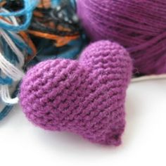 Yarn leftovers are used to fill the heart brooch.