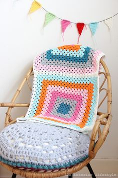 Colorful baby blanket by IDA Interior LifeStyle - I like the idea of just a couple of large granny squares to drape over the back of a chair.