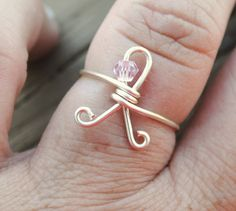 A little goes along way to show your support. | Adjustable Wire Wrapped Ring Breast Cancer Awareness Ribbon via Etsy.