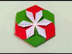 Very easy DIY paper coaster. Fabric Origami, Diy Origami, Diy Paper, Paper Crafts, Flower Decorations, Christmas Decorations, Origami Lotus Flower, Origami Ball, How To Make Origami
