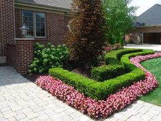 Like the golden red leaved tree, white/green hydrangeas, boxwood(?), and begonias with brick.  Very varied texture and form.    Novi Front Landscape Redesign - landscape - detroit - Executive Landscape