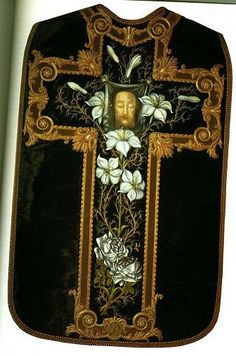 Chasuble made by St. Thérèse. The chasuble itself was made from an old dress of Madame Martin's. It appears to be a heavy brocade type fabric. It is dark green in colour. St. Therese painted the Holy Face and the vines and roses. Wow! Not only was the Little Flower so holy, she was so talented, too!