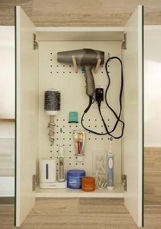 Add additional storage with a Pegboard bathroom cabinet Bathroom Renos, Bathroom Storage, Master Bathroom, Bathroom Cabinets, Bad Inspiration, Bathroom Inspiration, Pegboard Storage, Kitchen Pegboard, 1950s Bathroom