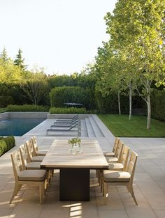 straight lines + rectangles : small lawn + row of trees : wide steps + lounge chairs