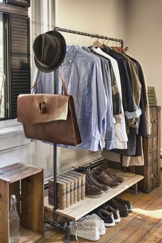 Steel pipe clothes rack with wood shelf. This would be lovely in a mudroom.