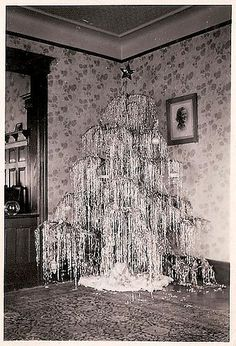 overflowing of tinsel as xmas tree! am not ready for xmas yet, still 2 weeks of summer left, but where are the bulbs for the tree? Noel Christmas, Retro Christmas, All Things Christmas, White Christmas, Christmas Tree With Tinsel, Silver Tinsel Tree, Christmas Drama, Country Christmas, Christmas Lights