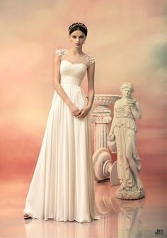 Papilio 2015 - Cap sleeve chiffon wedding gown with petal detail on the sleeve.