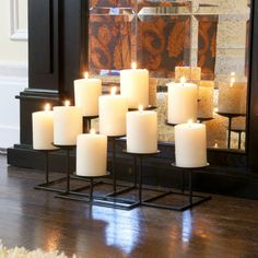 Place candles in your fireplace for a fire feel in your home, or cottage.