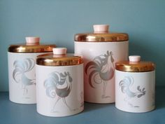 ♥ Vintage Pink and Copper Nesting Rooster Canisters by Ransburg.  I've got the kitchen dispenser in this color/pattern, but not the pink canisters...sigh.