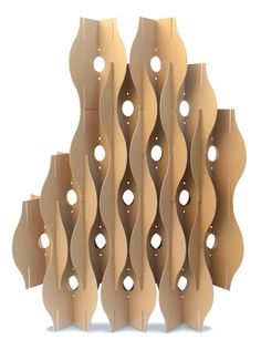 Cardboard Wall / I chose this piece because I really enjoy the way the cardboard is used and cut to intersect and make different shapes and lines. I think it's another good idea for working with cardboard.