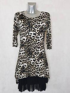 28feb6dd507e  Robe femme  évasée motif  animal avec  jupon noir en résille et manches