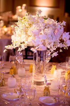 LOVE this orchid wedding centerpiece