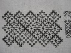 Blackwork Band. Now this is just gorgeous. The OP thinks it's too modern, but I think it looks like reticella (sp?) lace. Besides, as counted blackwork goes, this would come together quickly and make really elegant cuffs and collar for a man's shirt.