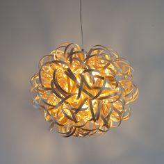 Woven Ash Strips that have been coiled and twisted around itself to make a stunning sculptural lighting pendant.