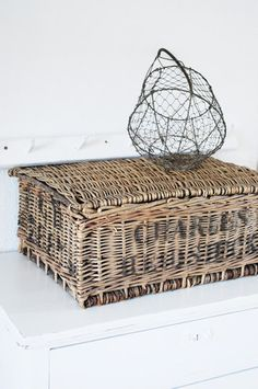 Individual wicker containers for the tops of their dressers to hold treasures. Customize with stencils?