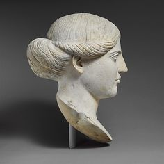 Marble head of a woman, 1st-2nd century A.D. Roman.