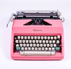 How can we resist?  A pink Olympia.  Refurbished (by an experienced former Olivetti technician we might add).  And those turquoise shift keys.  Sigh.  All from El Granero out of Spain.