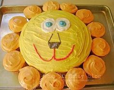 B-day cake idea: lion cake with cupcakes for the mane. (One box of cake mix will make one round cake and 12 cupcakes, can put less batter in round cake and get a 13th cupcake to fill in the mane)