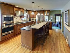 Single wall (I-shaped) kitchen remodel by McClurg Remodeling & Construction Services.
