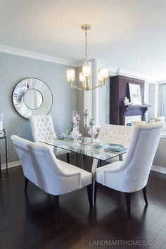 This dining room has some modern style features like the high back chairs. Penny  Lane