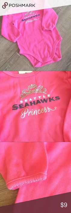 "Seahawks Princess Onesie A must have for your tiniest princess 12! Washed but never worn this onesie is sooooo soft. Check out my other Seahawks gear for your baby! Go Hawks!!  🍭🍬25% off all kids bundles!!🍬🍭 Click ""ADD TO BUNDLE"" button on all the items you are interested in.  Make offer for 25% less on the bundle and I will ACCEPT! team apparel One Pieces Bodysuits"