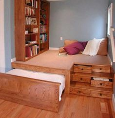trundle bed under raised floor | perfect for a kids room, put away the bed so there's more room for activities