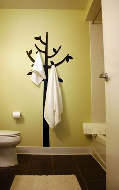 Paint the tree and add the hooks, cute for the kid's bathroom ~~
