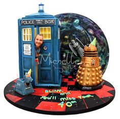 I would soooooo love this for my 40th b-day!  I love that the Daleks and K9 both have party hats on, and the weeping angel!!!