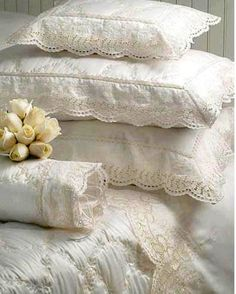Lots of pretty pillows...I like to have pretty things around me...at home I get to have things the way I like them.